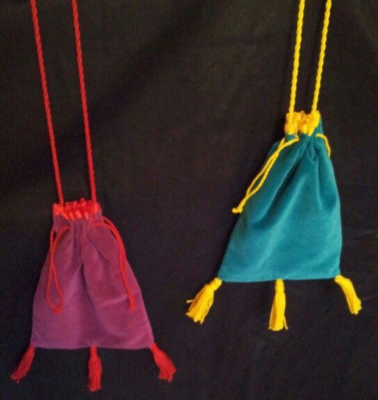 Matched cotton velveteen pouches, with penguin-printed cotton lining (a personal reference for the recipients), cotton tassels, drawstrings and hanging cord, with hand-sewn eyelets. Made for Christmas 2013.