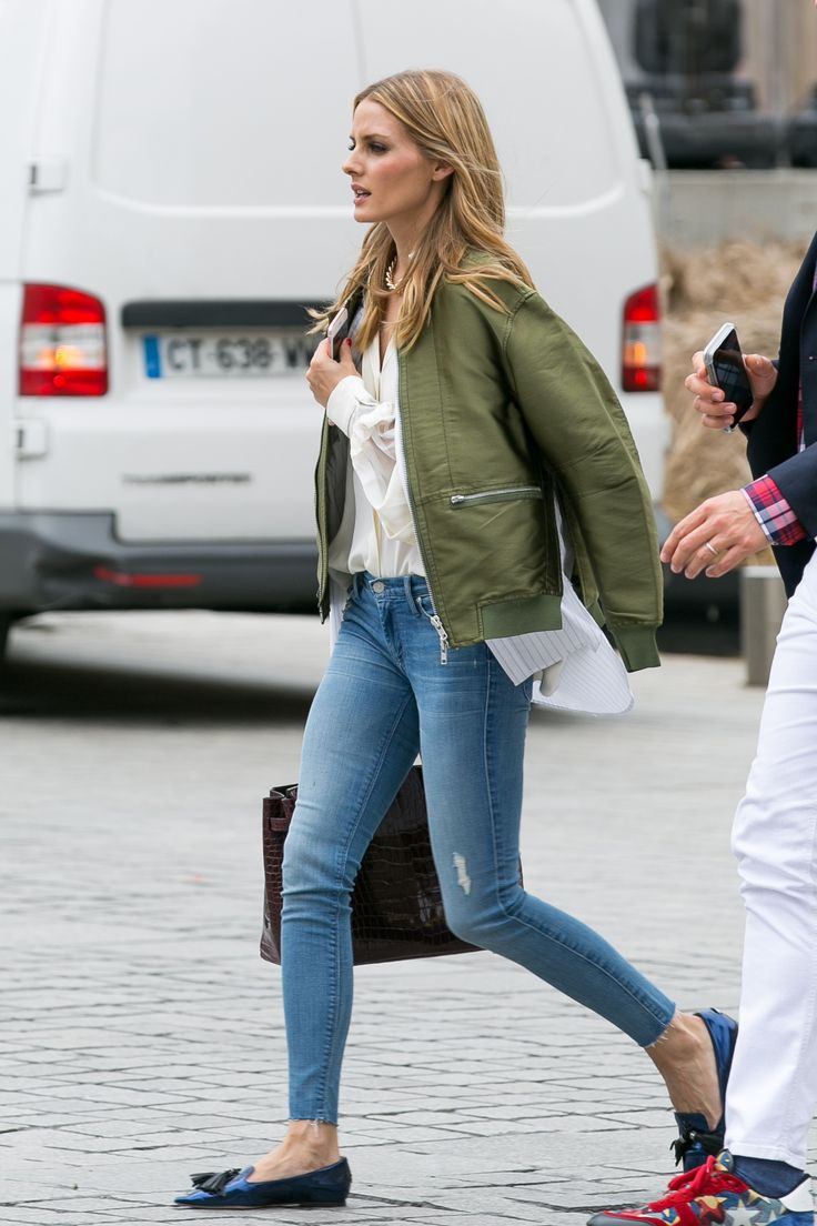 Olivia Palermo wears 3.1 Phillip Lim shirt tail bomber jacket, white blouse, skinny jeans and teal pointed flats.