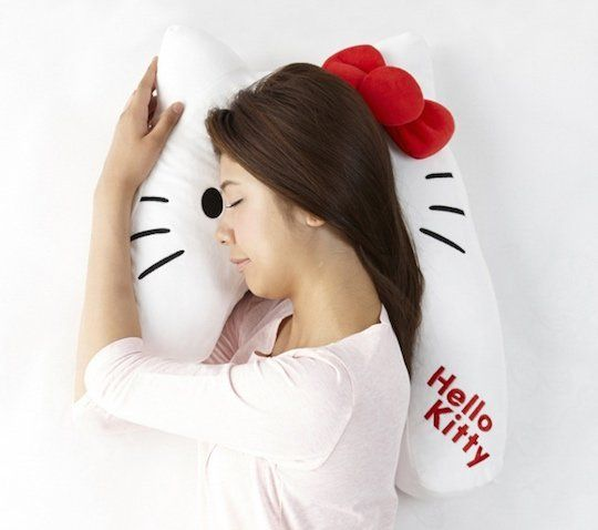 Sleep Vantage Hello Kitty Pillow - One look at the Sleep Vantage Hello Kitty Pillow should be enough to end any possible future discussion: it's a unusually shaped pillow made to look like Japan's best-loved feline, Kitty-chan (aka Hello Kitty). In other words, it's the most Japanese thing you can have so everyone should get one, rig ...