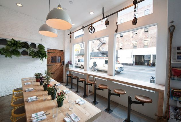 The Butcher's Daughter in New York features a menu of vegan food and juice concoctions. The interior features all kinds of butcher related items– a seemingly large contradiction to the name, and stepping outside the *norm* for juice bars. #NYC #RetailDesign #Juicing