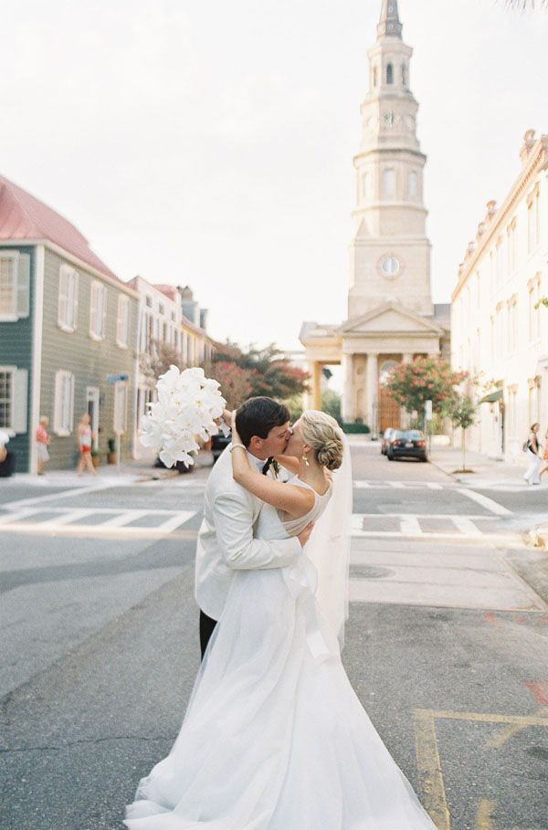 I have very unfortunately not been to Charleston yet, but weddings like these that strike such a lovely balance between preppy, coastal, elegant, and feminine have me wanting to plan a road trip ASAP. Cameron and Evan have grace and style for days, and the details they chose for their wedding–from Cameron's gently cascading orchid …