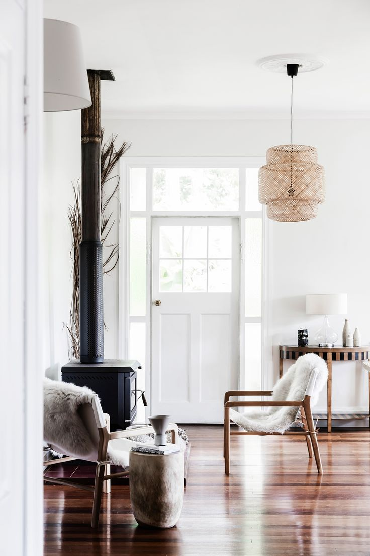 The entrance to this cottage in Byron Bay is immediately cosy and inviting with fur laden chairs in front of the fireplace. Photography: Maree Homer | Styling: Sarah Ellison