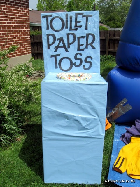 haha - Toilet Paper Toss game - big hit with the kids.  It's just 2 cardboard boxes taped together for height, cut a hole in the top + inserted a toddler toilet seat. Wrapped clear tape around 3 rolls of TP that were about 1/2 used so they wouldn't unravel.  The kids had to toss them in. Tips: tape a plastic grocery bag under the seat for easy retrieval of TP.  We also put a brick in the bottom box so it wouldn't blow over.