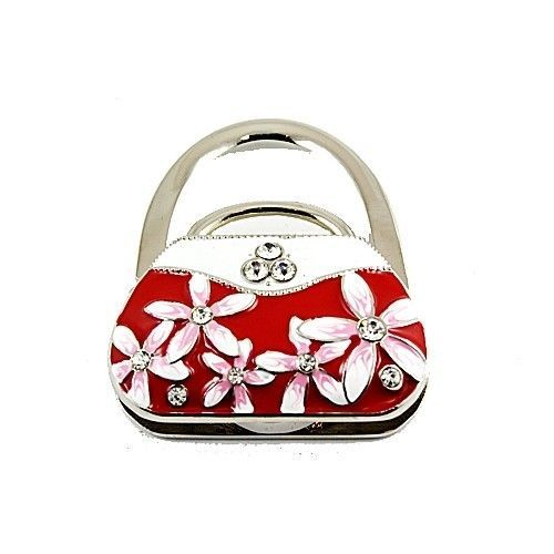 Desk-Handbag-Hanger-Purse-Hooks-Key-Holders-Table-Jewelry-Caddy-Organize-Closets This little purse accessory is great when dining out. Lack a place for your purse. Not a problem. Just pull this item out of a small pocket and voila a place to hang your purse is found. Simple but stylish