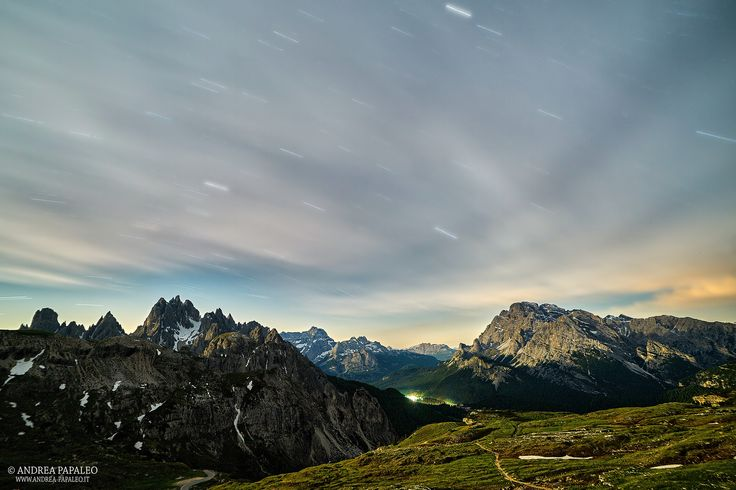 Photograph Stars and clouds over the mountains by Andrea Papaleo on 500px