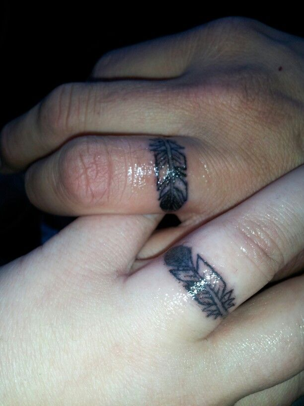 His and hers wedding ring eagle feather tattoos. Hubby and I just got these today. Original concept by: sunnywindsong (me); drawn and tattooed by Jeremy at independent tattoo, Albuquerque, New Mexico.