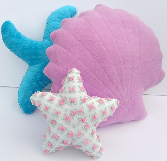 Scallop shell pillow! Orchid colored fleece pillow measures 17 inches at widest point by 15 inches in height. Made from a very soft orchid colored fleece fabric to make it extra snuggly. I would describe the color as a pink/lilac color. Pictured with a vintage chenille pink rosette small starfish currently in my shop, and a teal minky dot curvy starfish medium sized starfish also in my shop Perfect addition to any nautical decor or baby nursery