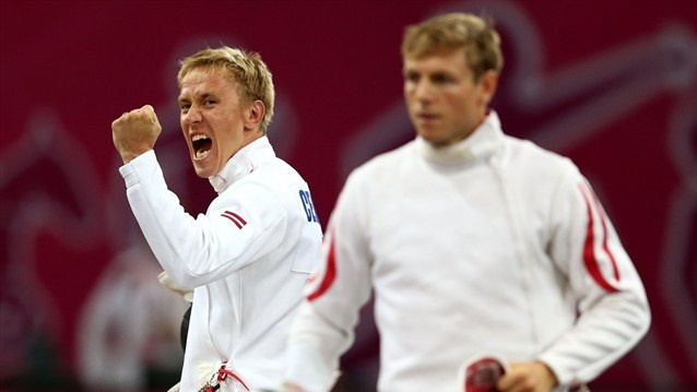Deniss Cerkovskis (L) of Latviawins his boutagainst Thomas Daniel of Austria during the men's Modern Pentathlon at the Copper Box.