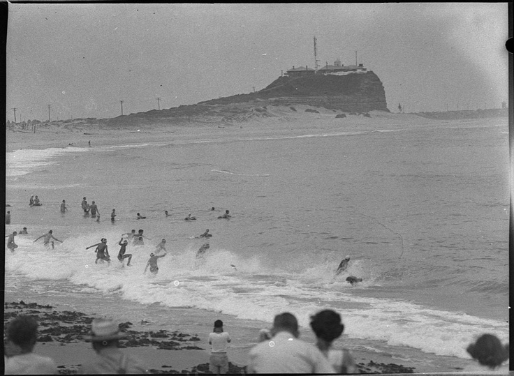 Surf race at Nobbys Beach (Newcastle), 1954 by Sam Hood. Round 2 of the Kellogs Nutri Grain Iron Man Series comes to Newcastle Saturday 12 January 2013 and there will be many surf carnivals at Sydney's beaches over the summer months. Search for the history of all things surf and lifesaving at http://www.sl.nsw.gov.au/