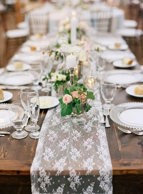 Seen mostly on wooden tables, lace table runners exude romance and can be paired with almost any table decor. They are sweet and feminine without having to add too many additional frills to the table.  White lace is a wedding go-to and it's easy to see why. Paired with your wedding colors and some candles and you have an instant wedding wonderland. Lace table runners are a top choice for rustic or vintage themed weddings.
