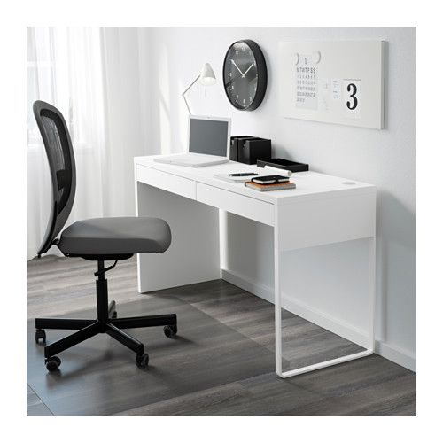IKEA MICKE desk A long table top makes it easy to create a workspace for two.