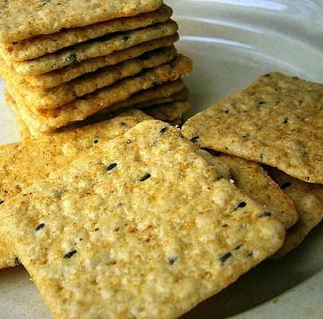Brown Rice Seaweed Crackers: 1 cup ground cooked brown rice 6 tbls water 1 tbls shredded seaweed 1 tsp baking powder 1/4 tsp baking soda Coarse sea salt for topping