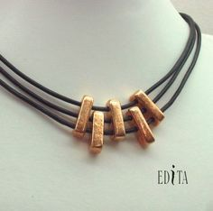 """Five handmade gold plated ceramic rectangles on leather ribbons.   Length: (approx). 16"""" long.  Black Beauty Israeli Jewelry made in Israel - Israeli Leather  at: www.israeli-jewelry.com"""