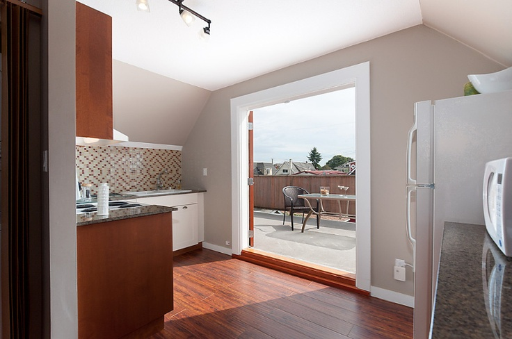 Make a tasty meal in the kitchen with the sun on your back filtering in from the large french doors which lead to an extensive deck.  #CommercialDrive #Vancouver #Rentals #Hotels
