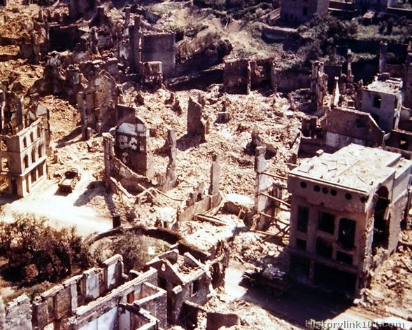 View of part of the demolished town of St. Lo, looking West from the tower of the St. Lo Cathedral. This series of 35mm shows what total war...