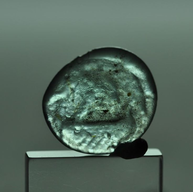 Roman navy, roman trireme on glass token, 2nd-3rd century A.D. Roman navy, Roman galley trireme with rows rapresented during navigation with wind that blow on its sails, little masterwork of roman art, 1.7 cm diameter. Private collection