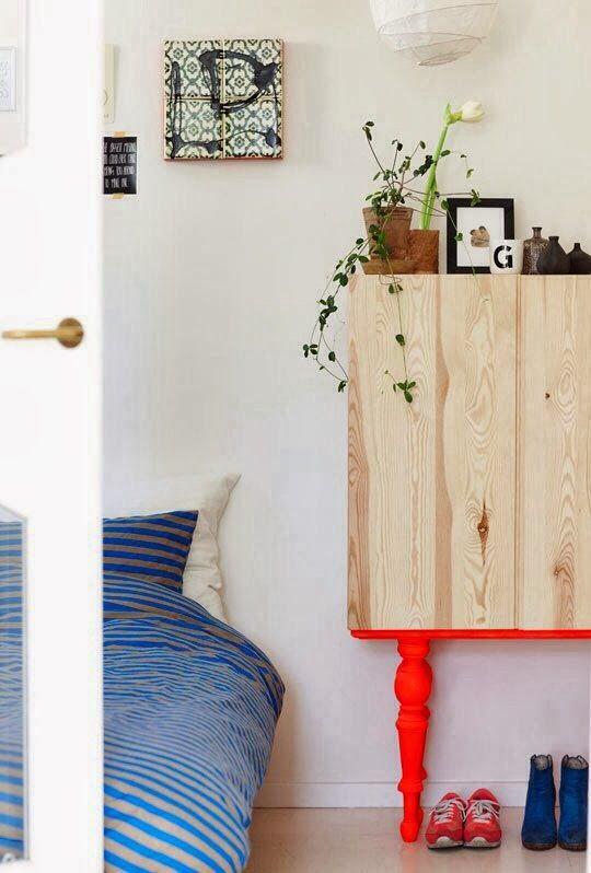 little birdie | love those elaborate neon legs on a very simple cabinet!