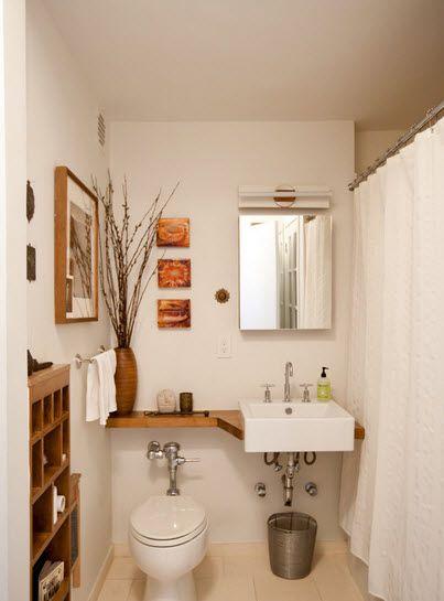 Ganando espacio a las áreas de un pequeño baño