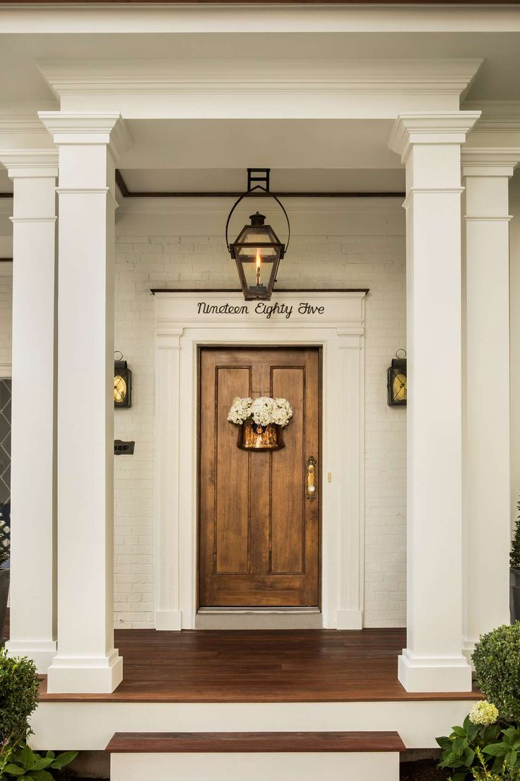 Front door of classic traditional house by The Fox Group. #frontdoor #classicarchitecture #housedesign #houseexterior #beautifulfrontdoor
