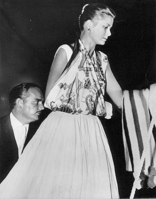 Princess Grace. This is how royalty deals with a broken arm - simply make a sling out of a Hermes scarf! Simply divine!