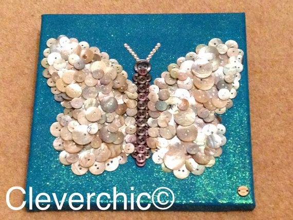 Mother of Pearl Buttonart Butterfly on teal blue by Cleverchic1