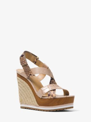 c6d361d6ac Designed with an exotic mix of embossed leather, the Mackay wedge combines  a jute heel with a wooden platform and striped trim.