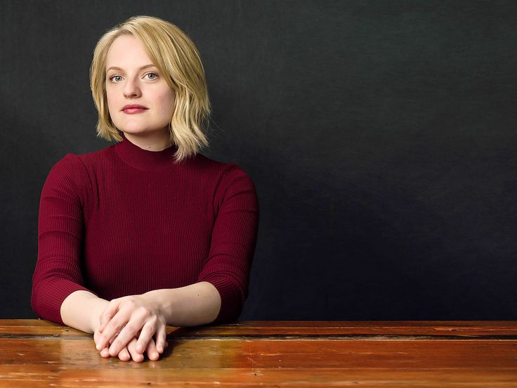 """It was the weirdest scene I have ever done in my career,"" Elisabeth Moss says. She is referring to a key scene in the new Hulu series The Handmaid's Tale. In the scene Moss wears a blood-red dress and a white bonnet as she lays splayed across a bed, her head in the lap of actress Yvonne Strahovski. A door slammed, and Joseph Fiennes walked in."