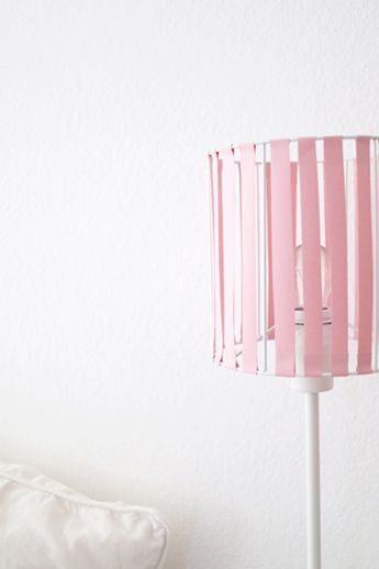A DIY for geometrical paper bedside lampshades in Pantone rose quartz by Luloveshandmade.