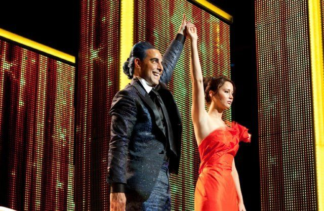 Stanley Tucci as Caesar Flickerman and Jennifer Lawrence as Katniss Everdeen in The Hunger Games.