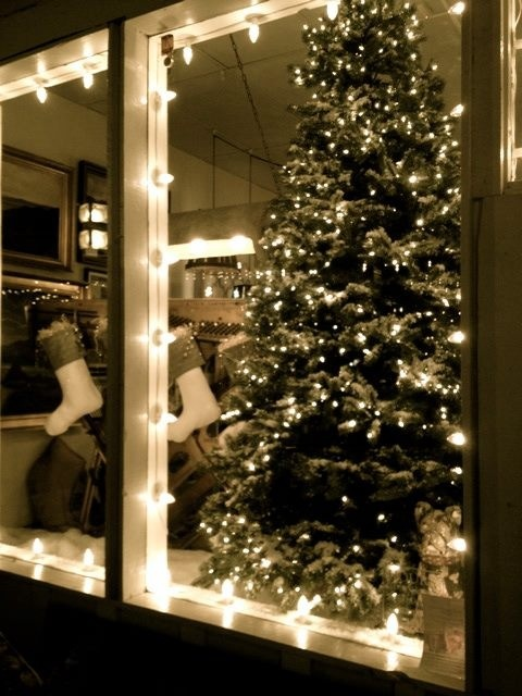 front holiday window during christmas time christmas tree lights snow stockings display whats in store pinterest christmas christmas tree and