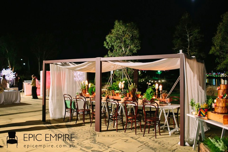 A wonderfully arranged gazebo: Bentwood chairs contrasting with white sleek table, accentuated with lush botanicals and candelight tablescape.  http://www.epicempire.com.au/bentwood-chair/ http://www.epicempire.com.au/table-with-a-frame-legs/