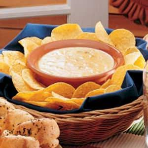 Chili con Queso Recipe ~ INGREDIENTS: - Medium onion - Garlic cloves - Butter - Green chilies - Shredded cheddar cheese - Shredded Monterey Jack cheese - Milk - Tortilla chips