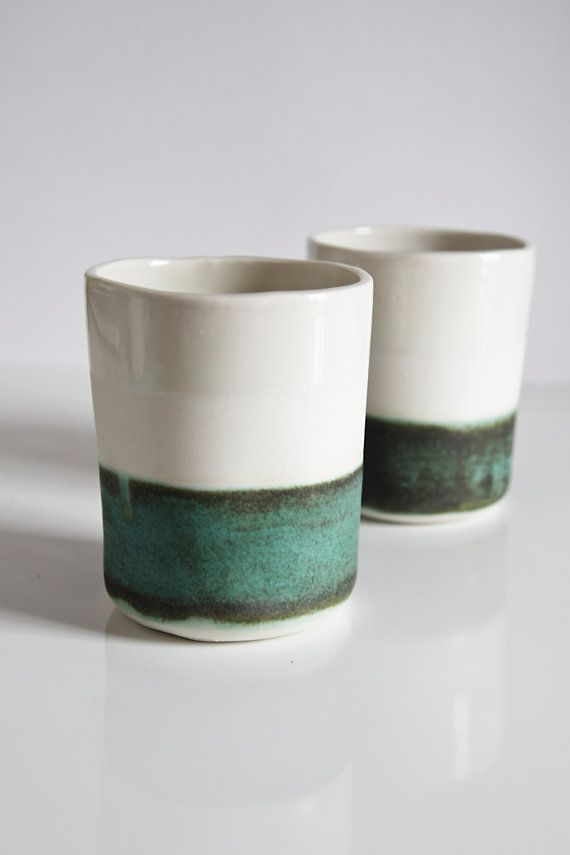 Beautifully simple and understated porcelain cups. -made of white porcelain - decorated with a green, verdigris band of artistic glaze -fully glazed