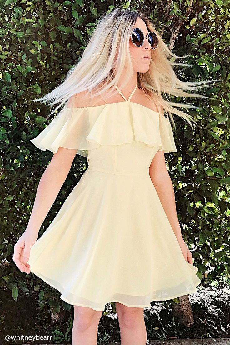 A mini woven chiffon dress featuring a self-tie V-strap halter neckline, a flounce layer forming short sleeves, a woven lining, and a flared skirt.