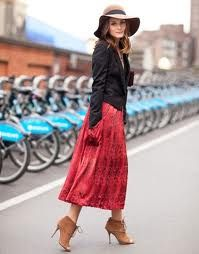 Red skirt with big pockets on the side. Luv the high heeled opened toe boot & floppy boho hat with short tux jacket.