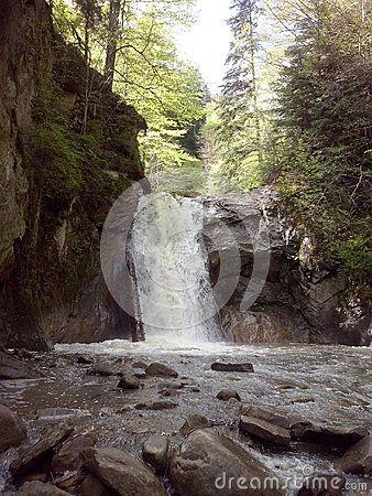 Water flowing between rocks, at Casoca waterfall, Buzau