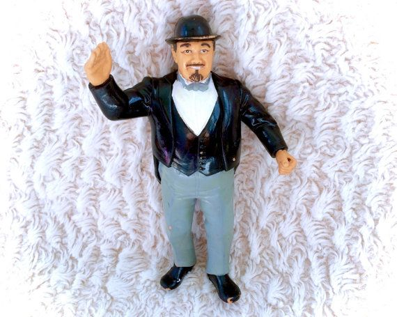 A sweet vintage 1985 Mr. Fuji Manager WWF LJN Rubber wrestler figure. In decent vintage condition with some paint rubs, and minor marks. Please see all pictures up close for a thorough representation of the item! I have TONS more cute vintage items for sale in my Etsy shop - check it out for SUPER CHEAP combined shipping discounts. ;) I ship WORLDWIDE from a clean, pet & smoke-free home! Please note that shipping times will be slower OUTSIDE of the US & Canada (up to 3 months in some…