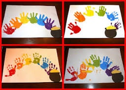 thinking about having my son paint his hands in rainbow colors as the runner for the party tables, on white tablecloth.