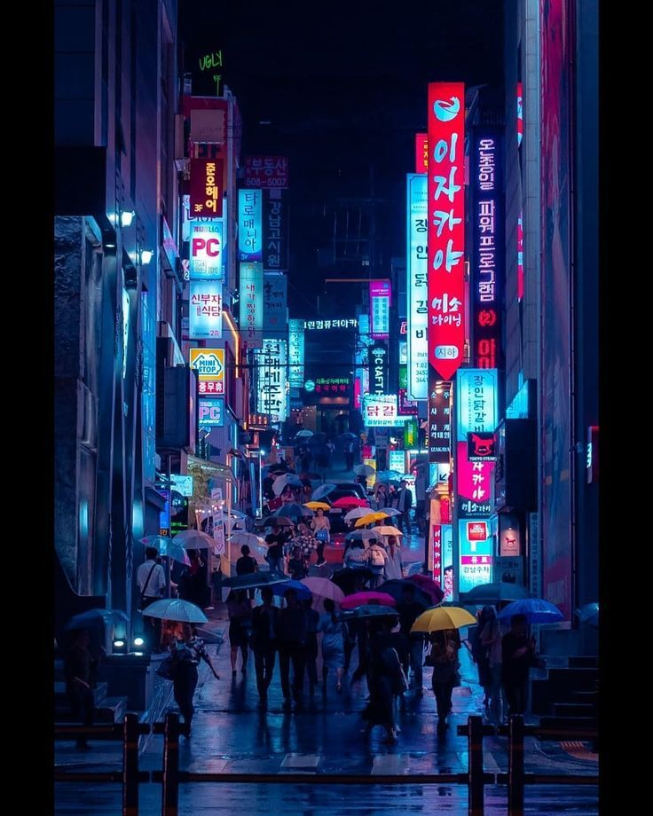 r\/CityPorn - Rain drenched street at night full of ...