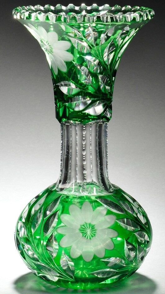An emerald green cut-to-clear glass vase,attributed to Dorflinger, with notched rim, trumpet-form neck and globular body, decorated with flowerheads and foliage   circa 1875-1899