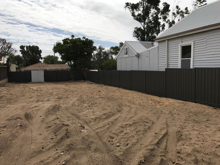 Colorbond fence installed in Nedlands, Perth, in Woodland Grey colour, using Gramline plinths.
