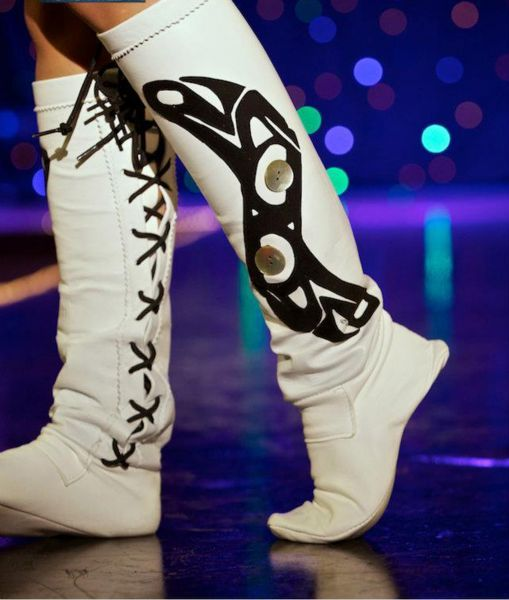 A model wears a pair of the creenisgaa clothing art leather boots at National Aboriginal Fashion Week in Regina.