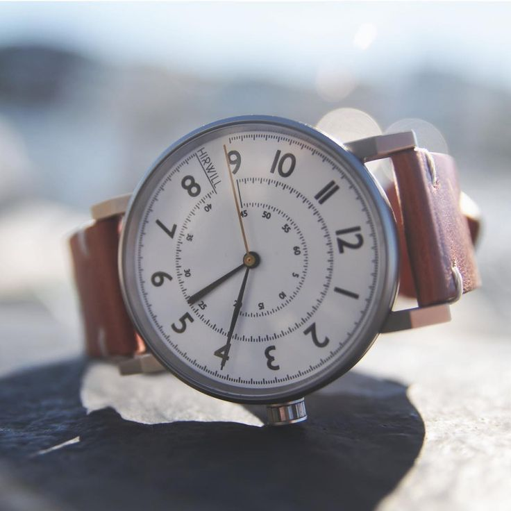 Hirwill Watches. Stainless steel case, white enamel dial and falu red leather strap.