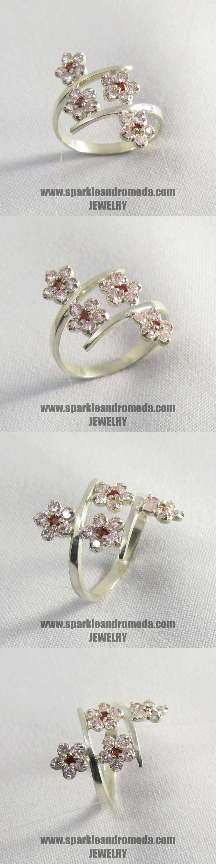Sterling 925 silver ring with 4 round 2 mm red almandine color and 20 round 2 mm pink morganite color cubic zirconia gemstones.