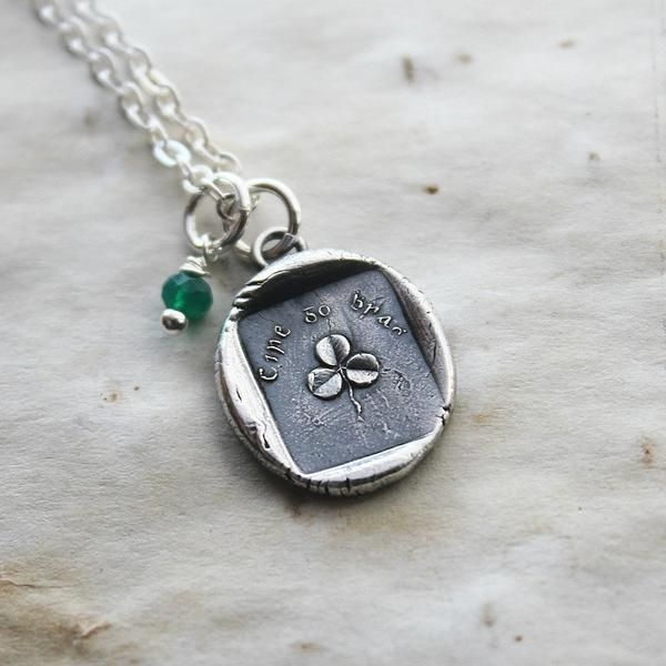 """Pictured is a sweet little shamrock with the tiny words """"Erin Go Bragh! over top, which means """"Ireland Forever""""."""
