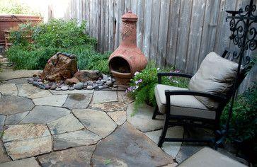 nice Texas backyard patio with hot tub, fountain and chiminea.