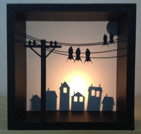 Shadow boxes cut on a Silhouette Cameo (layers of vellum & black cardstock) by Marie