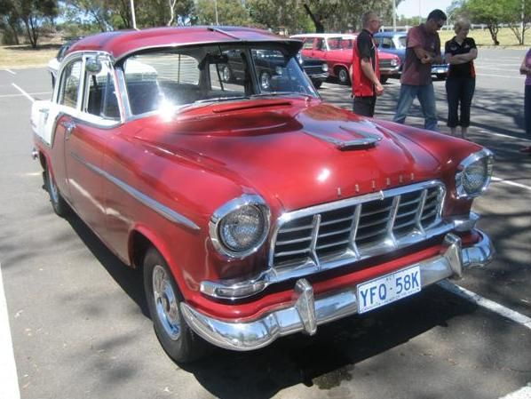 Red and White Vintage Holden