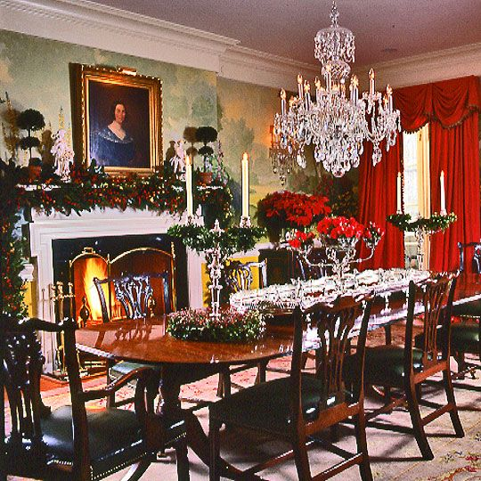 To Complement The Formal Dining Room Homeowner Chose Elaborate Holiday Decorations Including Masses Of Red Poinsettias On Sideboard