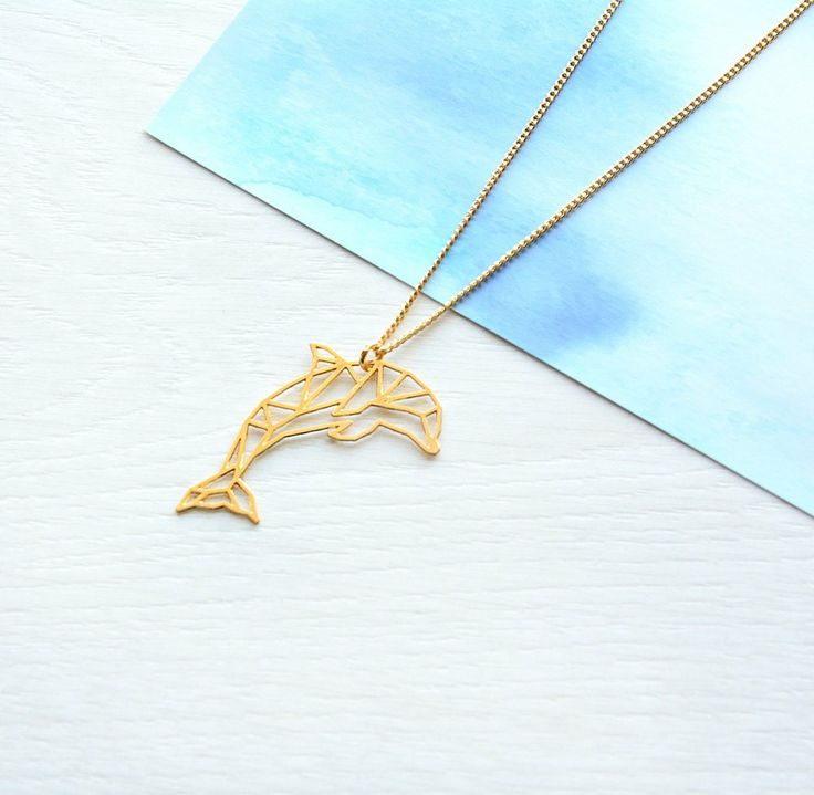 Excited to share the latest addition to my #etsy shop: Dolphin necklace, origami dolphin, dolphin charm, origami necklace, geometric necklace, animal necklace, personalised necklace, letter charm http://etsy.me/2hH9r70
